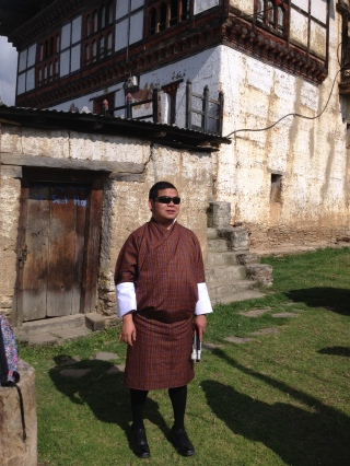 Photo of myself in front of an ancient house in Wangdue Phodrang Dzongkhag. Picture taken on 21st May 2017