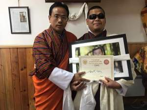 Photo of me with Hon'ble Education Minister after receiving the award. Image courtesy: Sherig Bhutan FB page.